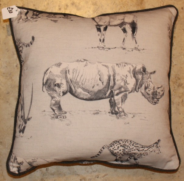 White rhino cushions with stripey piping for TWT