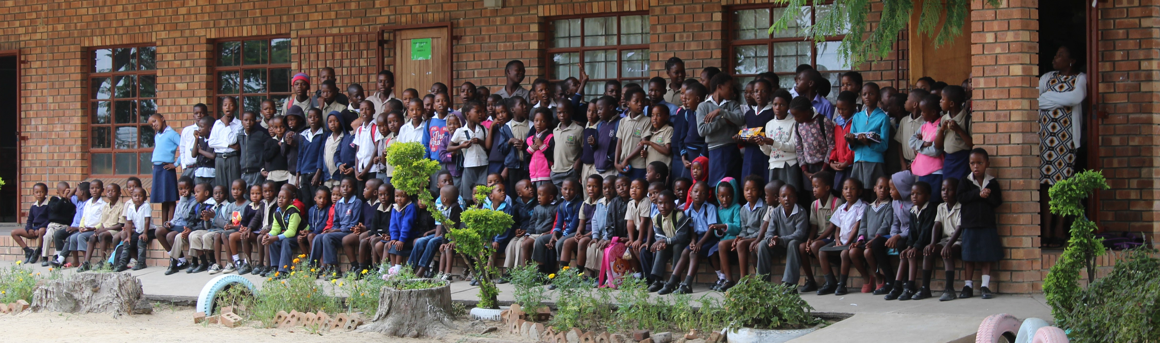 TWT Ride 2018 DAY 4 - Boschdraai Primary School who received gifts of pens and pencils from riders.jpg