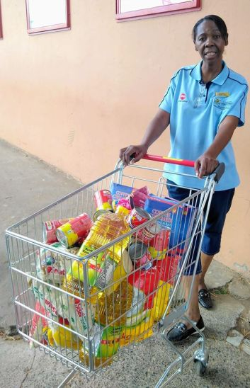 Nurse Grace buying groceries for food parcels