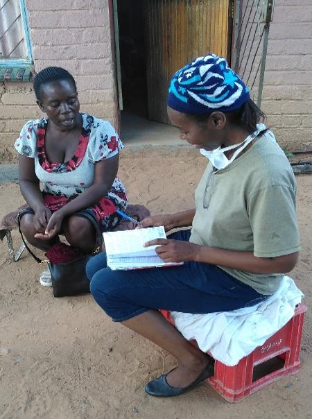 Nurse Grace helping lady in Leseding