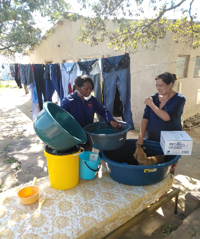 Nurse Grace with donations of clothes, bedding May 2020